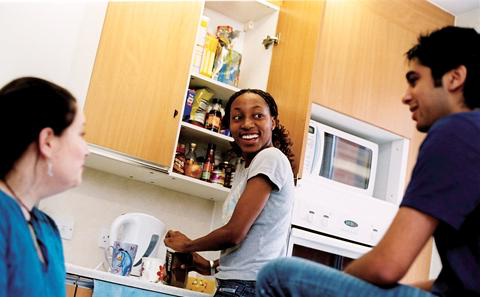 Students in a hall of residence kitchen